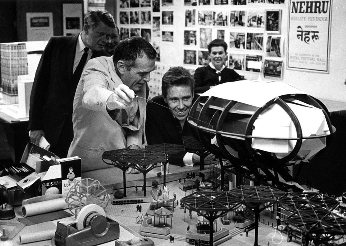 Charles shows Antony Armstrong Jones model of IBM Pavilion for NY Worlds Fair.