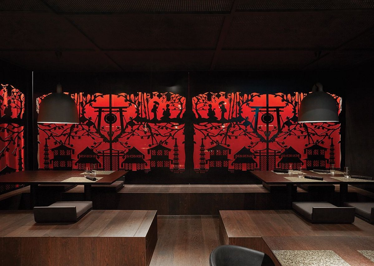 The Sushi restaurant picks up on natural timbers and shadow puppetry references.