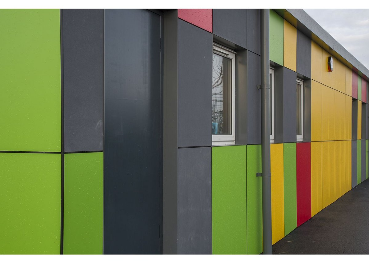 The colourful Formica rainscreen clad exterior of Barrow Hall Primary School near Warrington, designed by Ellis Williams Architects.