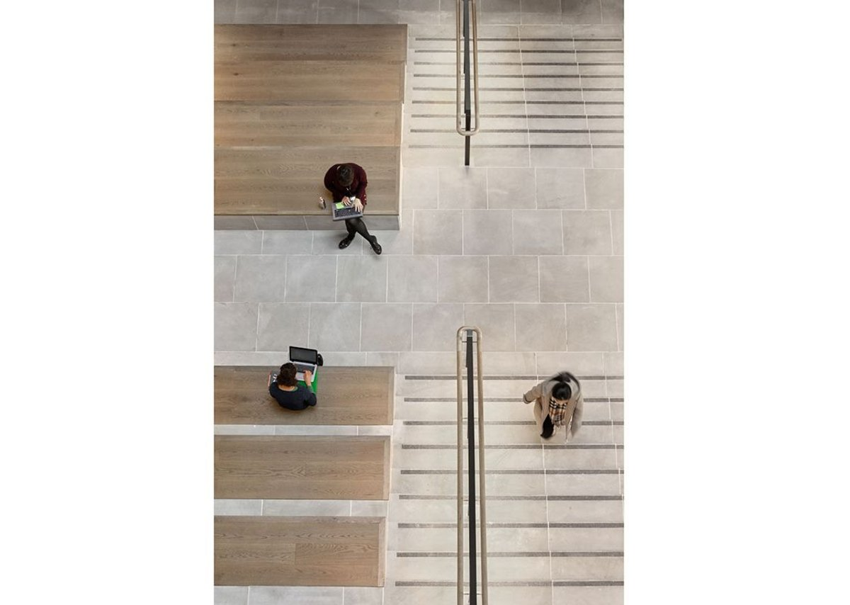 The auditorium steps from above with its York stone floors and oak timber seating.