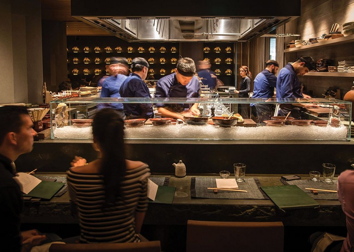Chefs are prominent in the open kitchen at Roka Aldwych in central London, designed by Claudio Silvestrin Architects.