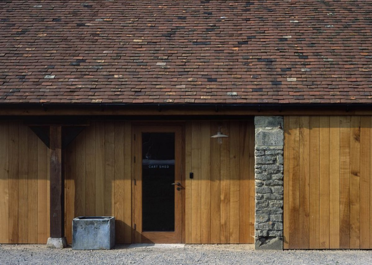 Natural materials complement the original buildings.