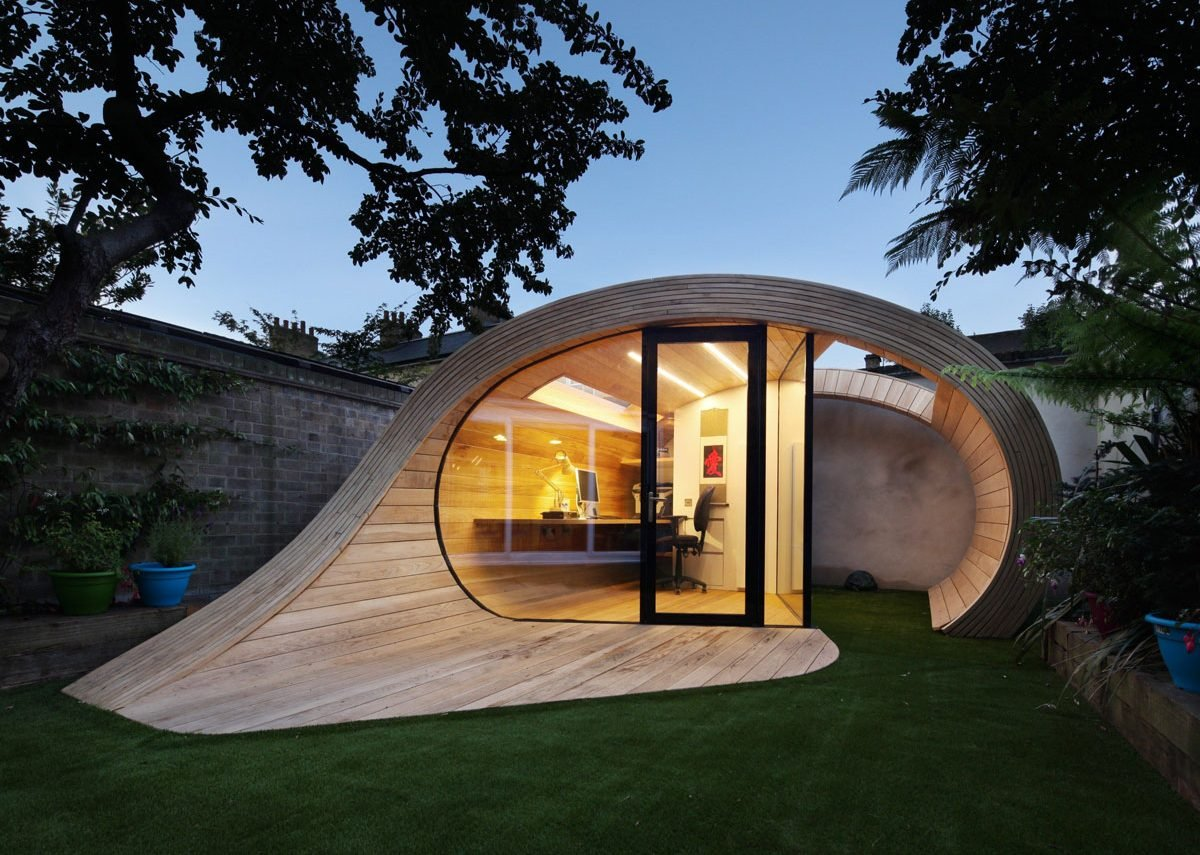 The sculptural form of 'Shoffice' enhances the garden.