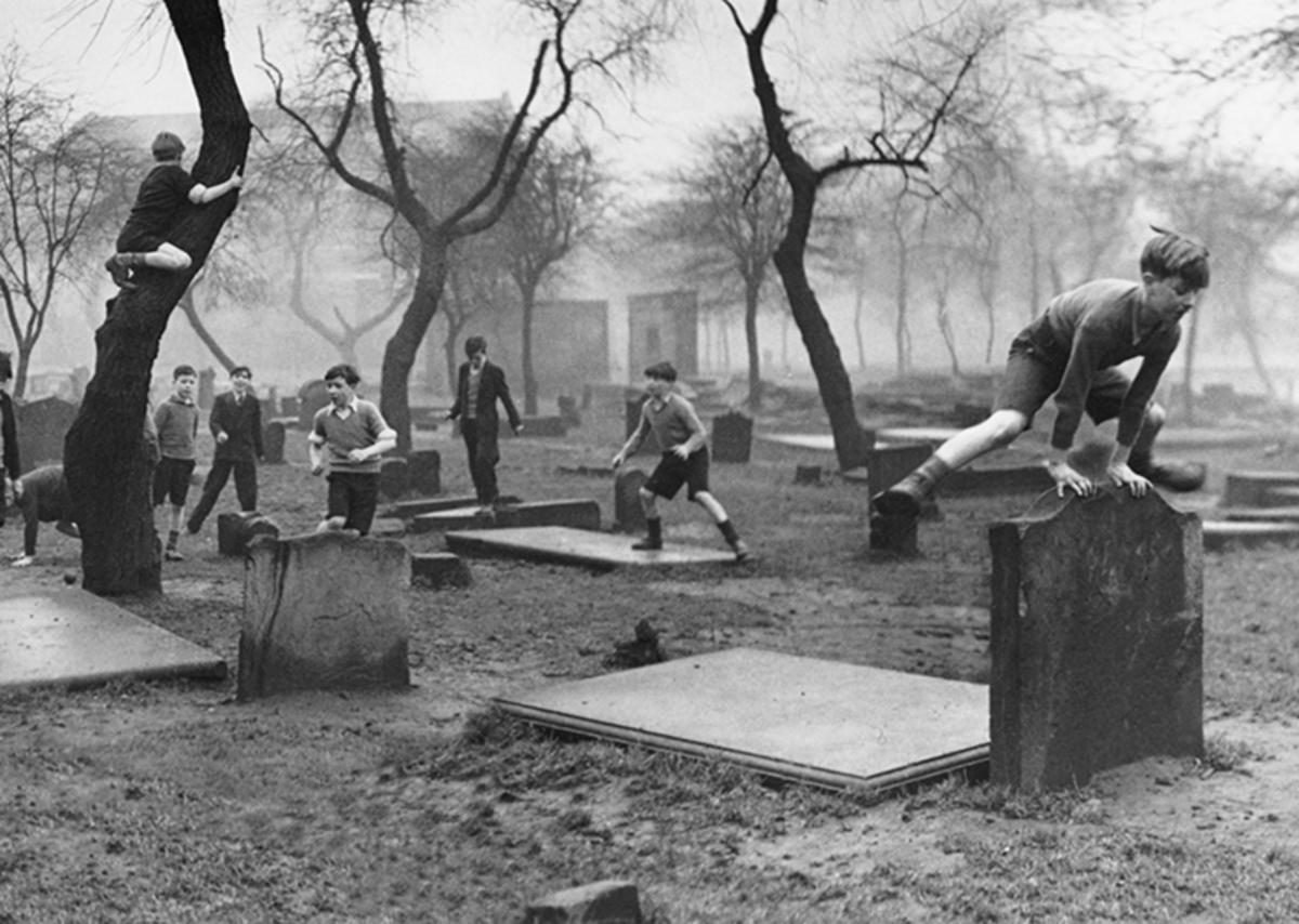 Boy leap-frogging gravestone, Bert Hardy, 1948.