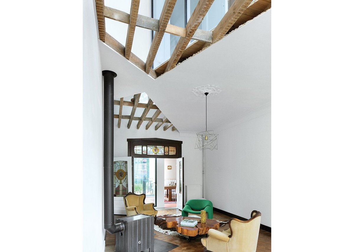 With the ceiling cut open to reveal the first floor windows, light pours into the living room.