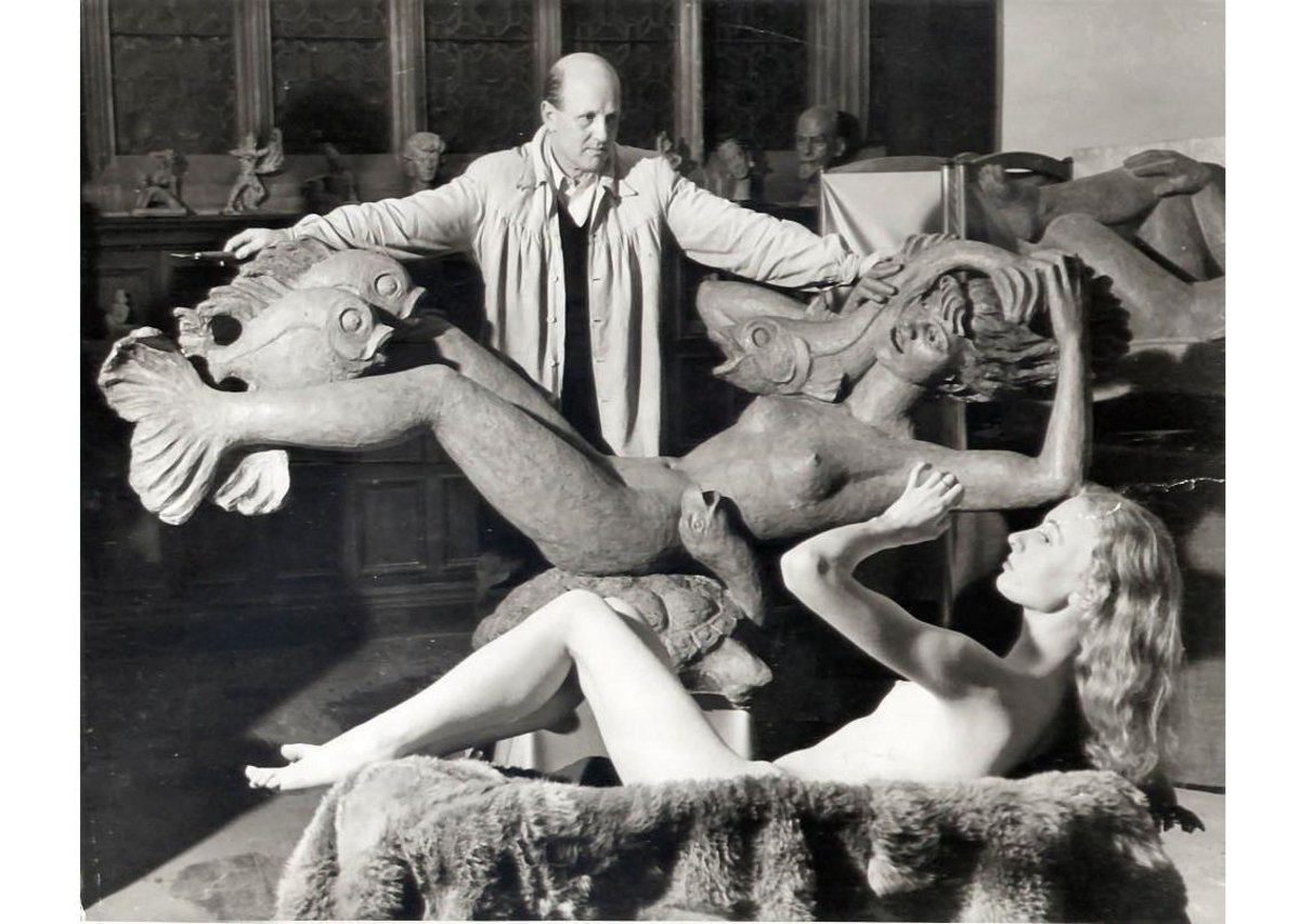 Arthur Fleischmann, Miranda, 1951. Image of the artist in the studio with the work and model.