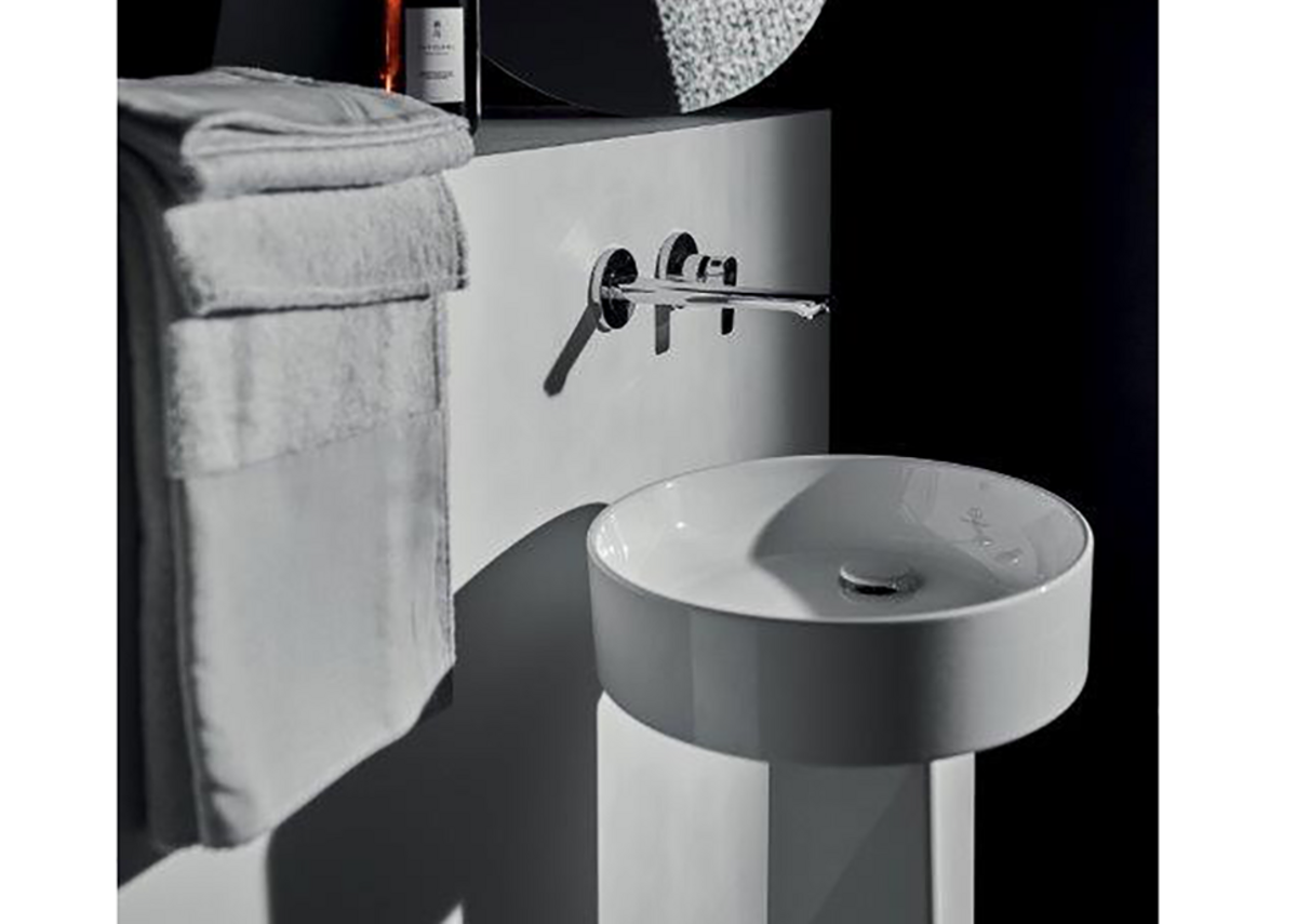 Conca 45cm-diameter washbasin and freestanding pedestal with Concept Air wall-mounted mixer tap in Chrome.