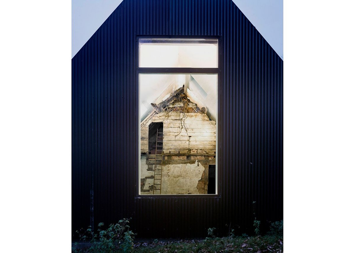 The new building encloses the existing 17th century cottage at Croft Lodge Studio, Leominster, designed by Kate Darby Architects and David Connor Design