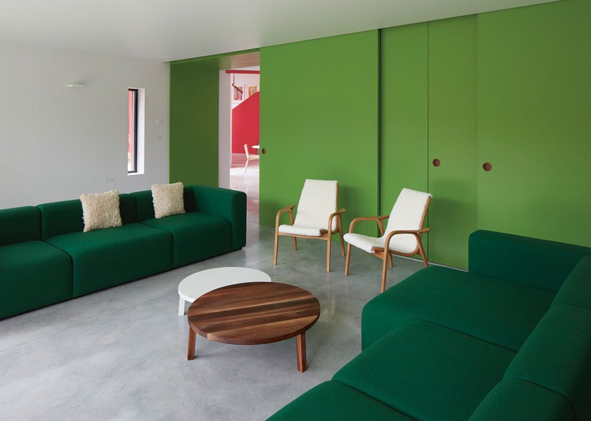 Single colour themes are used to define the building's various social spaces.