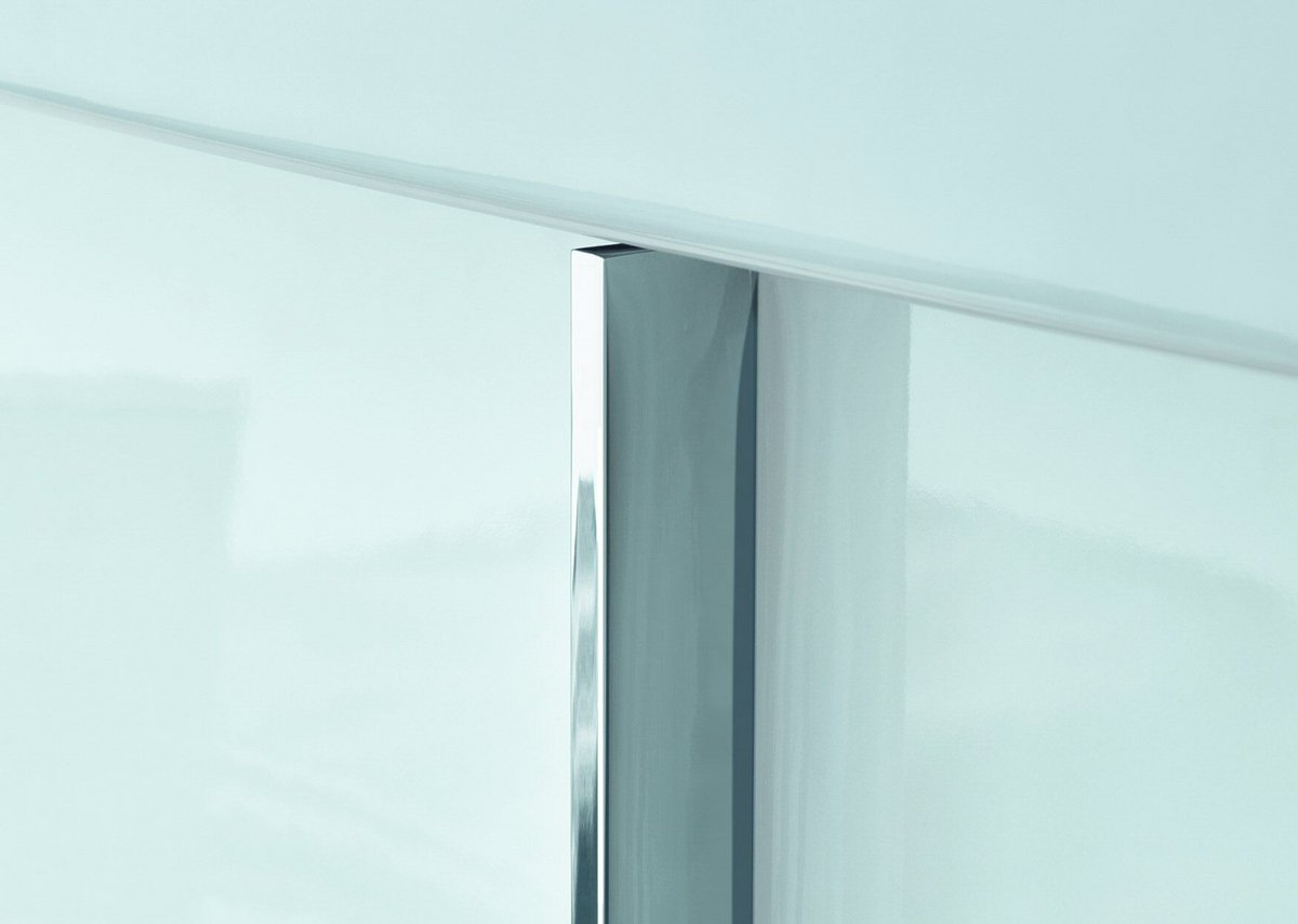 Inset vertical handles create a striking contrast to the classically modern form.