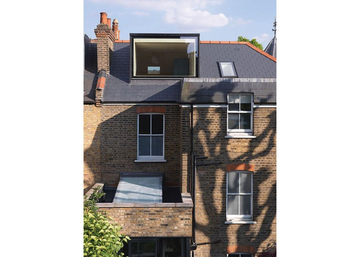 An expansive dormer opens up the 'treehouse' conversion of this top storey bedroom.