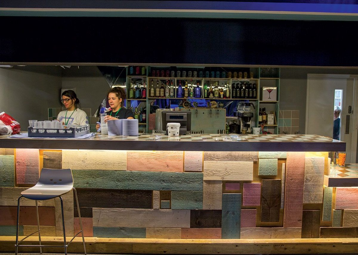 The bar is formed from the timber floor of the previous venue.