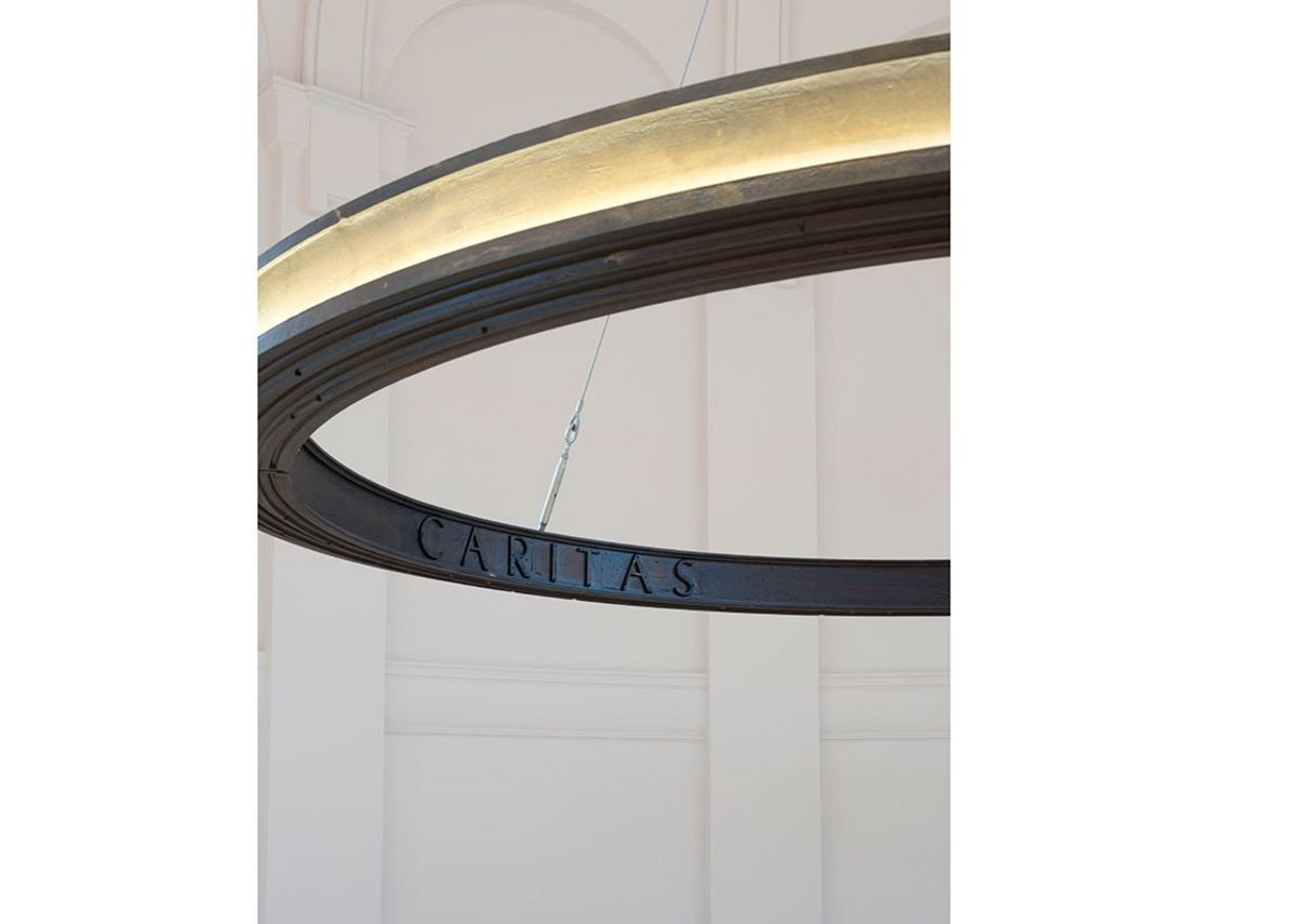 The cast iron light ring is inscribed with the Augustinian motto, Veritas, Unitas, Caritas'