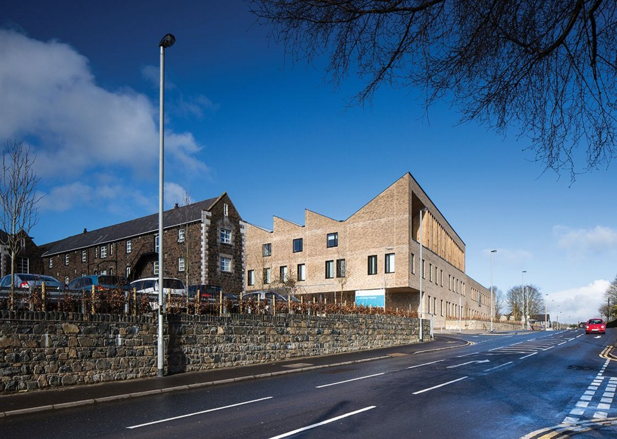 The new Health and Care Centre has an abrupt relationship with the road in contrast to the neighbouring former workhouse, although even the perimeter wall there has been raised as part of the recent works.