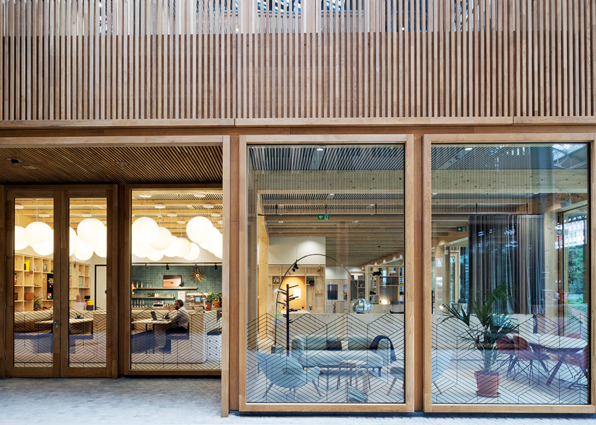 Pavilion doors and windows were specified in timber as part of a bespoke package that contrasted beautifully with steel structure of the original building.