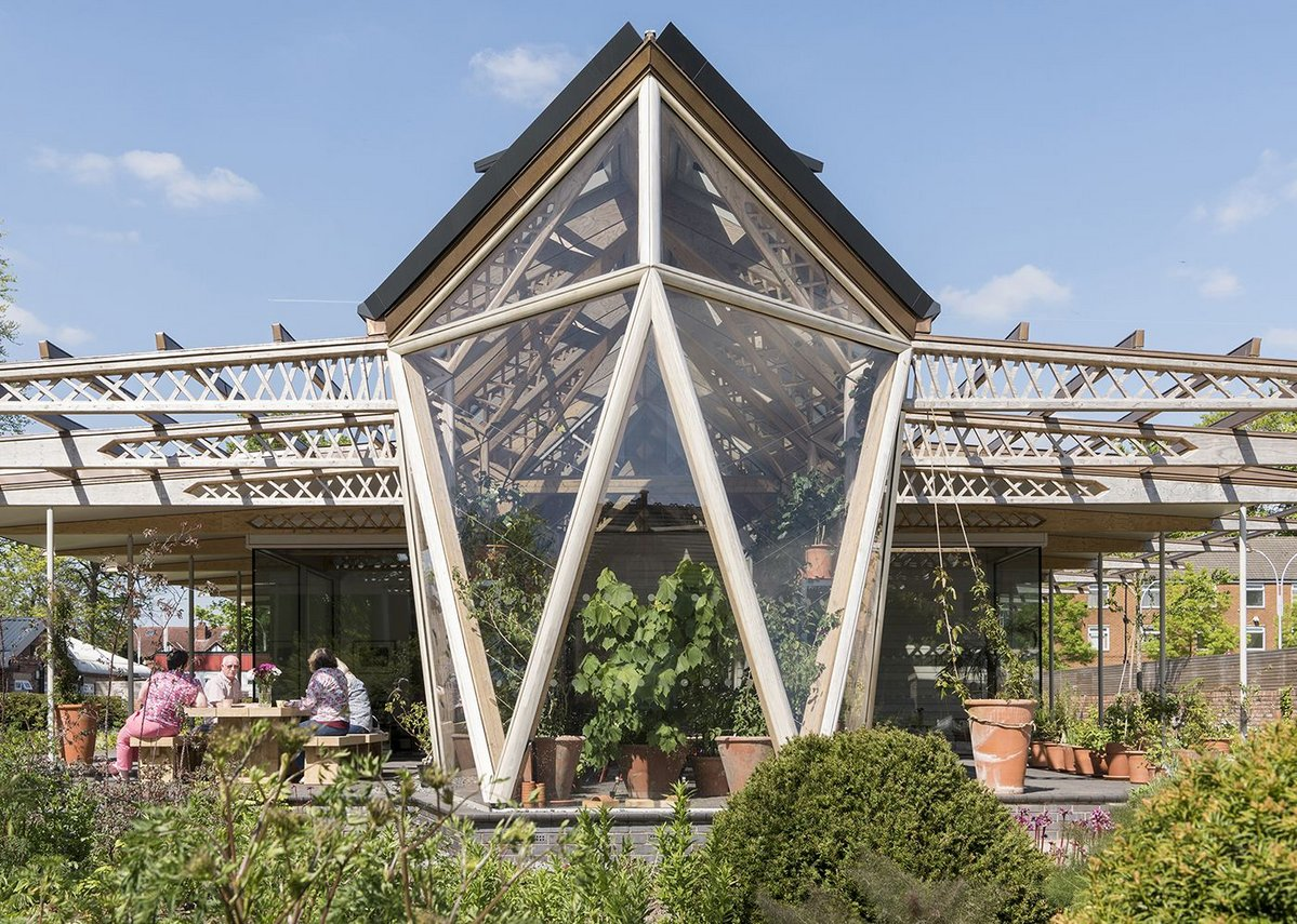 Maggie's Centre in Manchester, designed by Foster + Partners, includes a greenhouse where people can enjoy the therapeutic benefits of gardening.