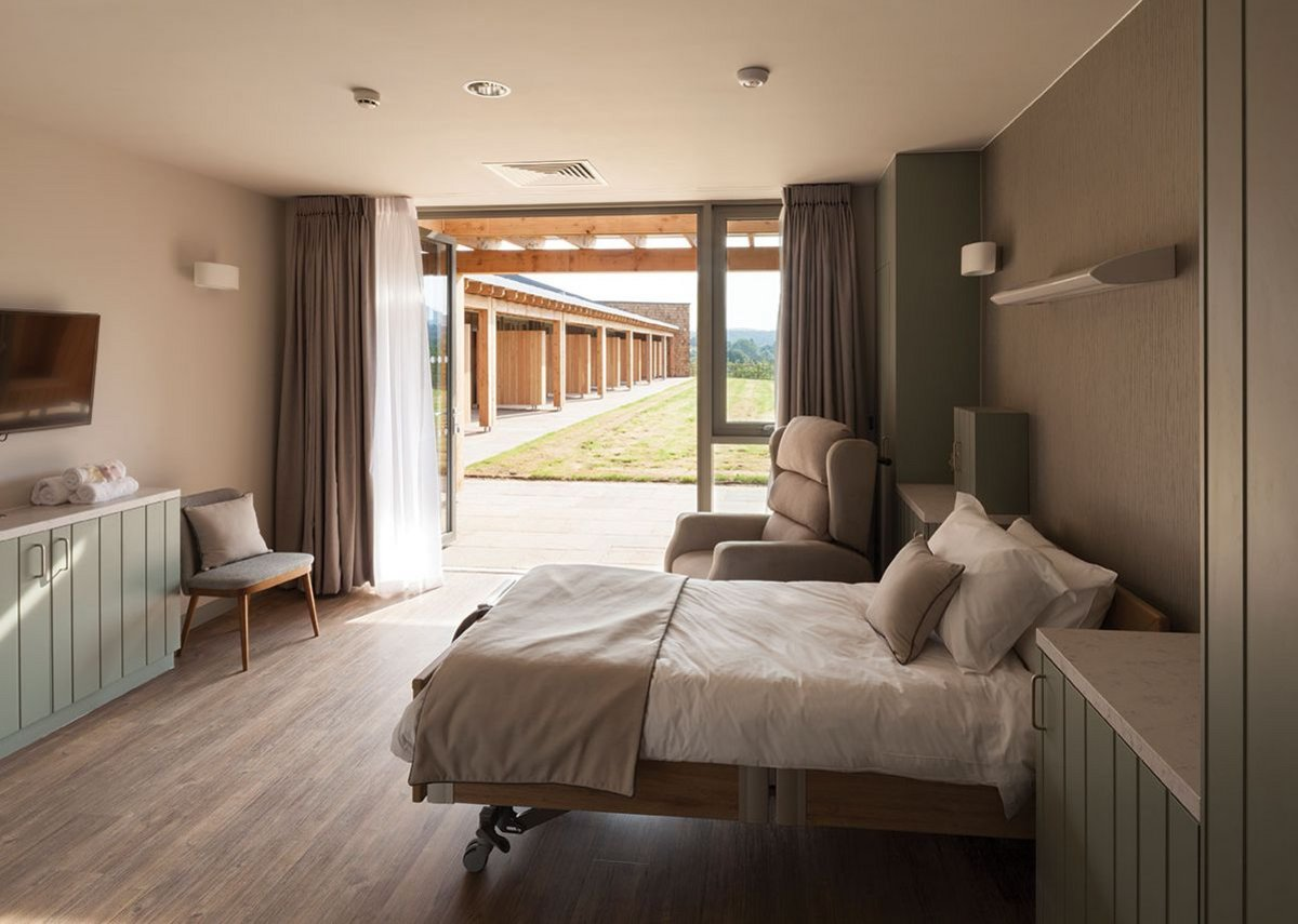 Above Bedrooms are calm spaces, designed with the 'patient's elevation' kept in mind. Fully opening bifold doors mean patients can be taken out into the fresh air.