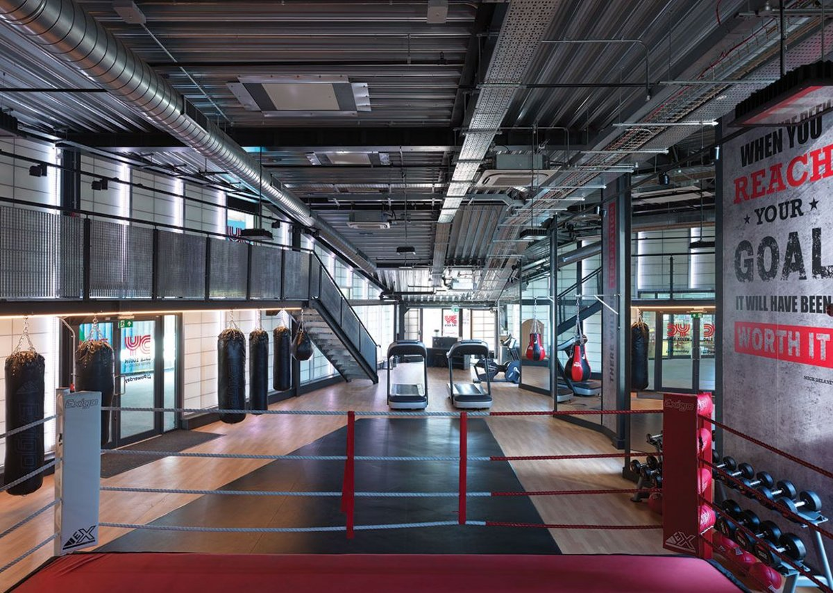 Featherstone Young considered prefabrication for speed but ultimately opted for steel frame – here left exposed in the boxing gym –  because there wasn't the head height for anything that needed to be craned in.