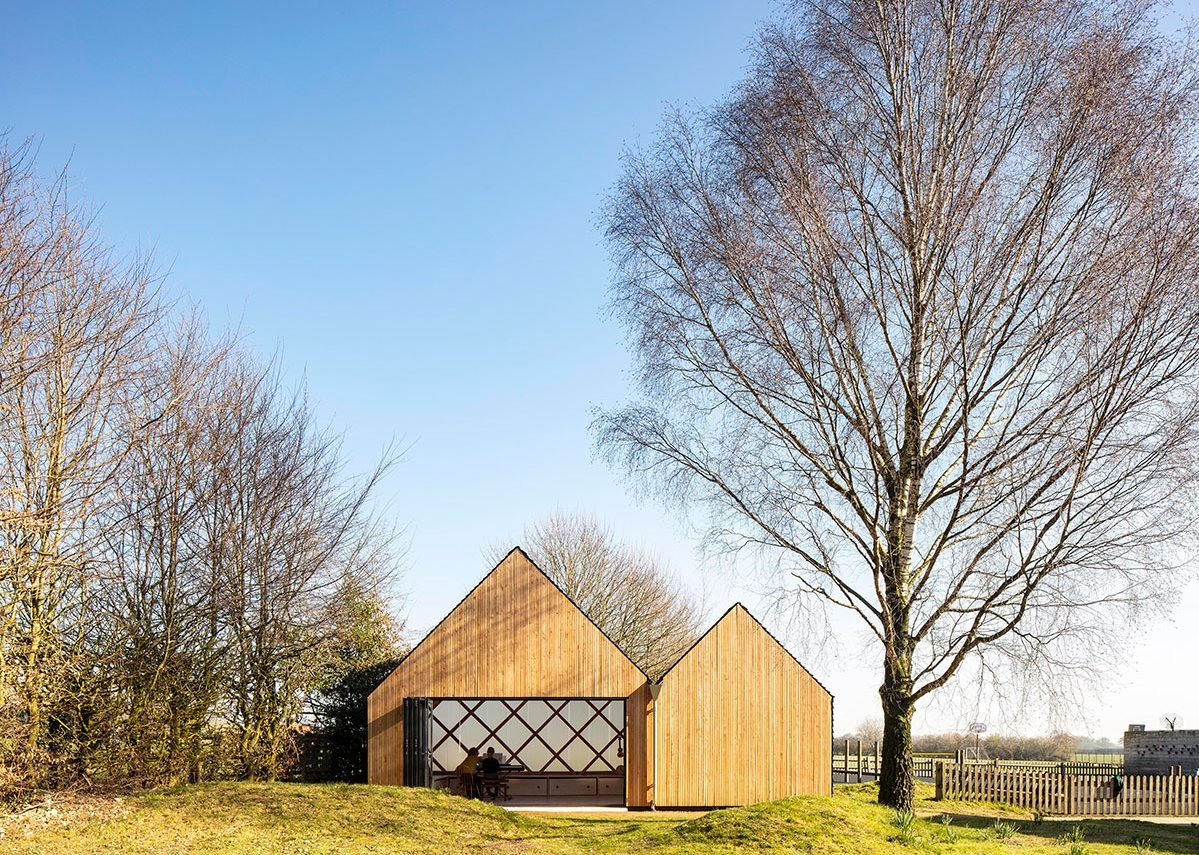 The double-pitched form of St. John's School Music Pavilion was inspired by the vernacular of local agricultural buildings at Lacey Green, Buckinghamshire.