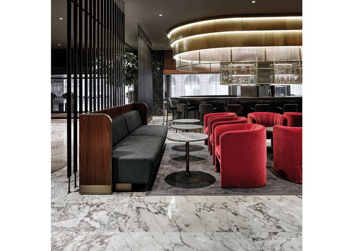 Space Copenhagen's velvet Loafer chairs complement Jacobsen's original furniture in the bar.