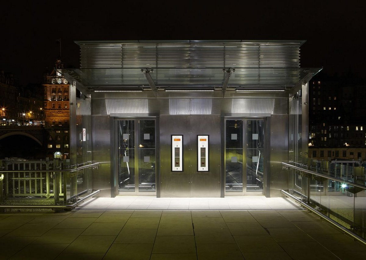 A pair of Stannah lifts installed outdoors at Edinburgh Waverley Station.