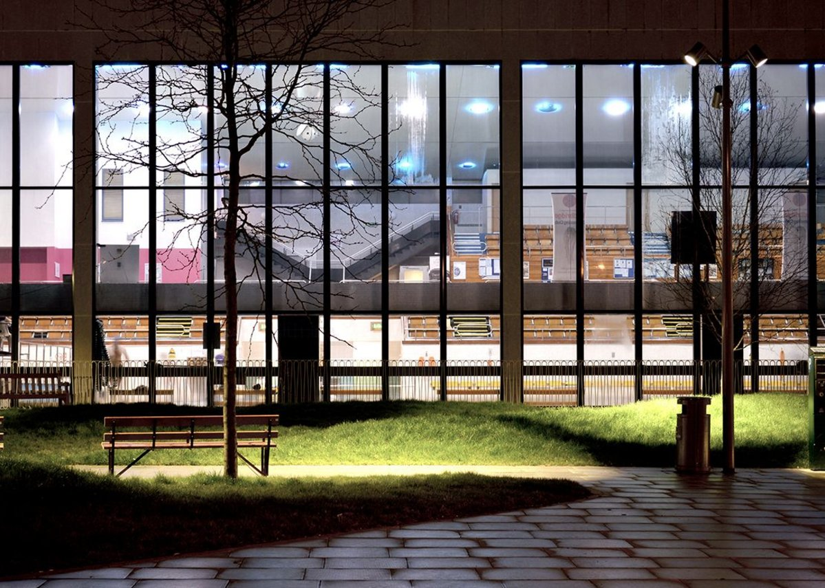 The gardens provide a night-time view of the leisure centre.