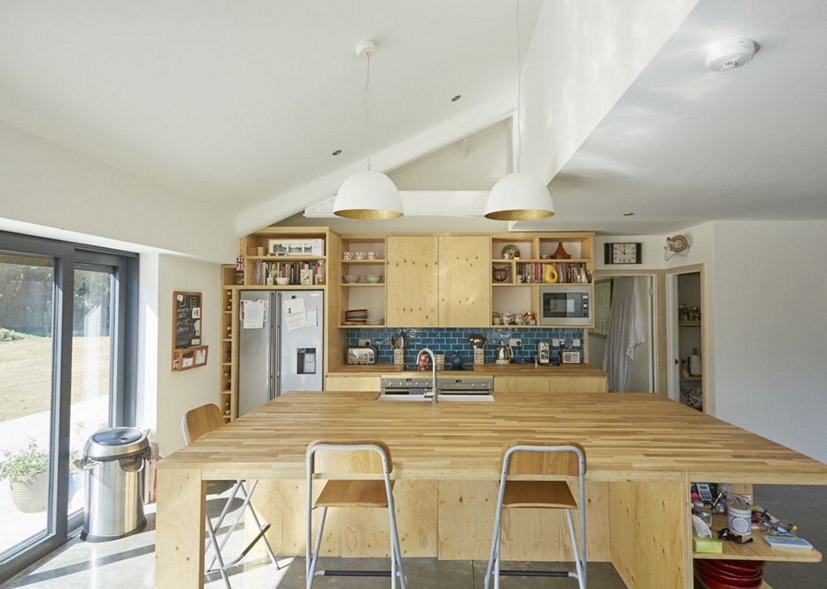 The kitchen at one end of the full-width living space.