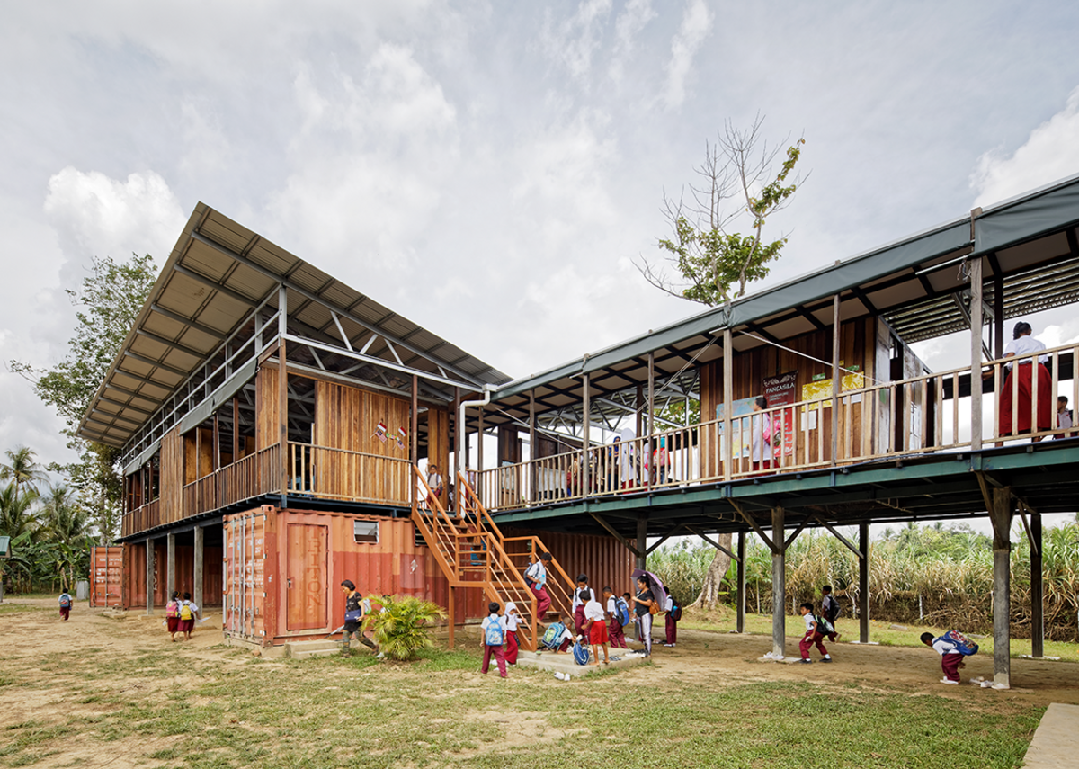 Etania Matakana Learning Centre in Malaysia. Architect billionBricks and design partners Architecture BRIO's elevated design is raised off the ground with five decommissioned shipping containers.