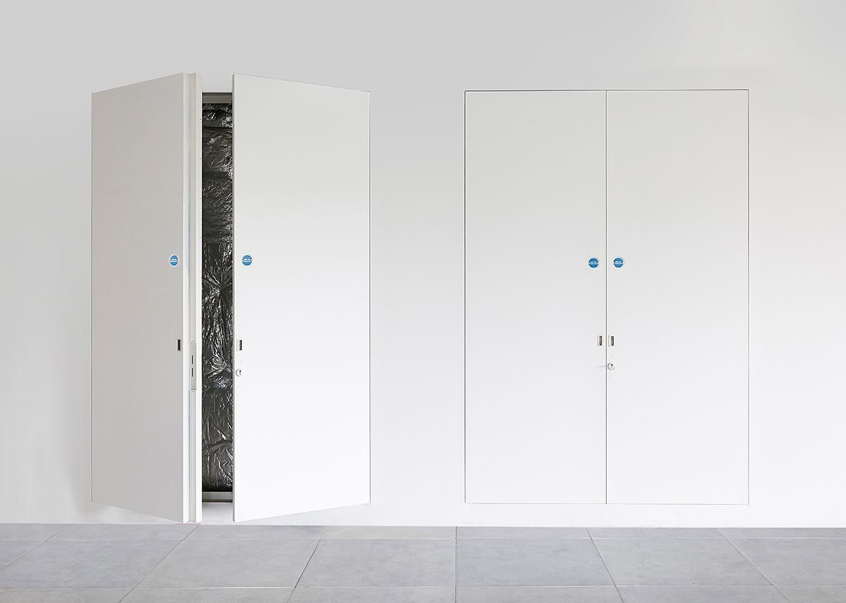 Hide unsightly apartment services using Quadra riser doors · Credit: Selo