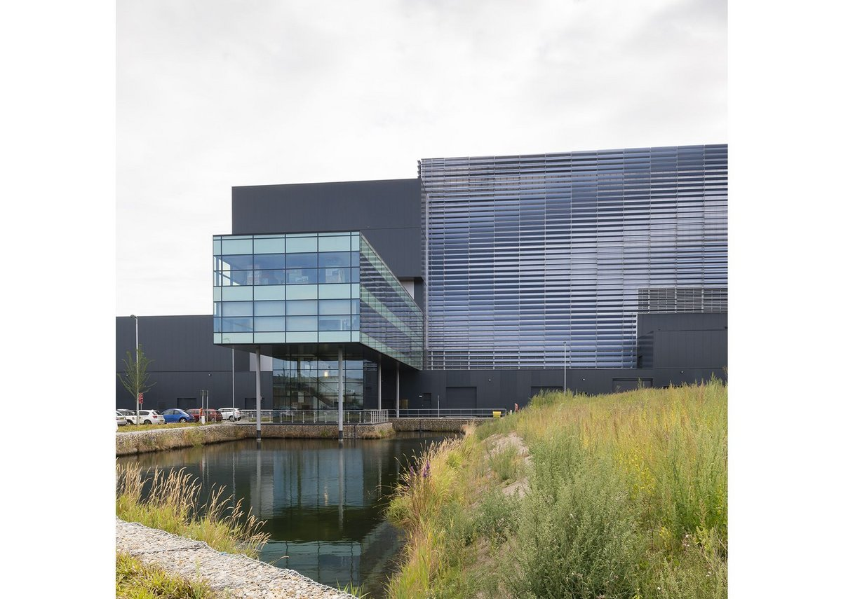 Visitors' centre and offices are elevated over a balancing pond and soft planting.