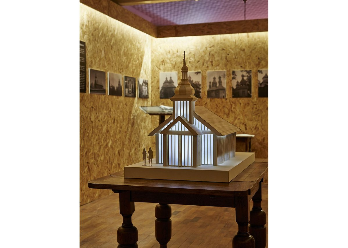 A model of the new church is at the centre of the exhibition, with photographs of Belarus on the surrounding walls.