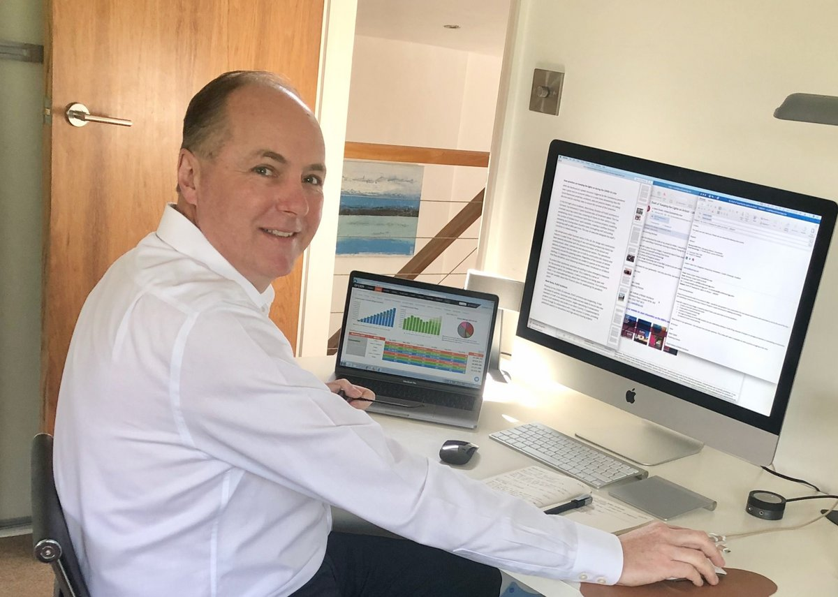 Michael Olliff, managing director, Scott Brownrigg, analysing business data from his home office.