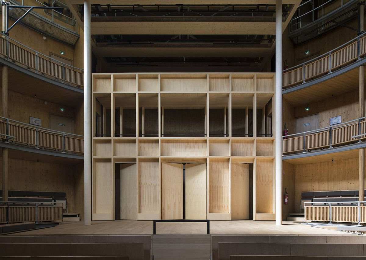 The stage set of the extra wall allows for balconies and dramatic entrances.