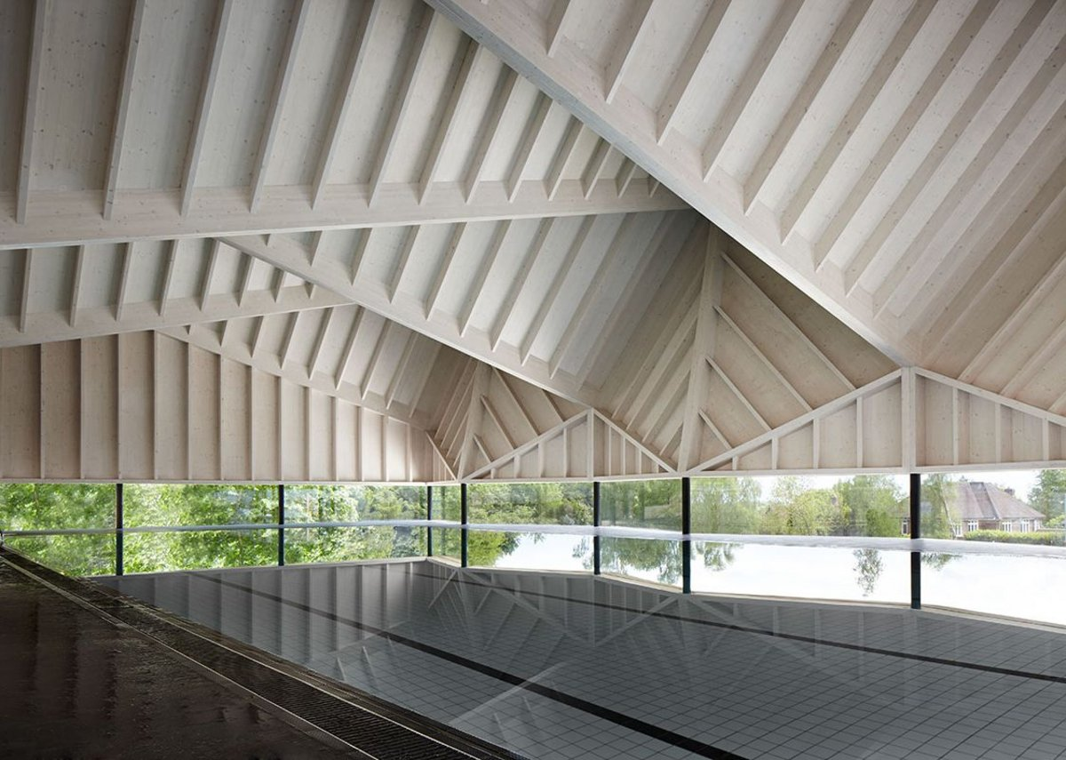 Folded CLT roof above the water on Duggan Morris' Alfriston Pool in Buckinghamshire.