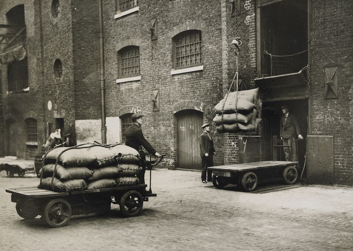 Sugar arriving by electric truck for loading into warehouse, West India Dock.