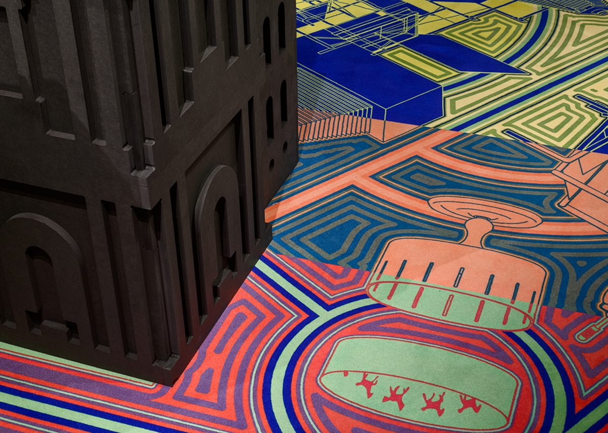 Detail of the carpet at the Freestyle exhibition, which is patterned with media innovations from the last 500 years that have influenced the development of architectural styles.