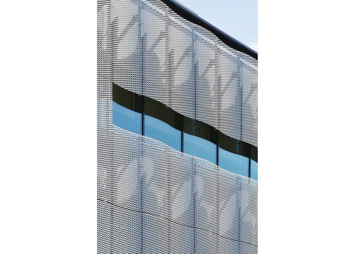 A sense of movement is provided by the sinusoidal perforated aluminium cladding.