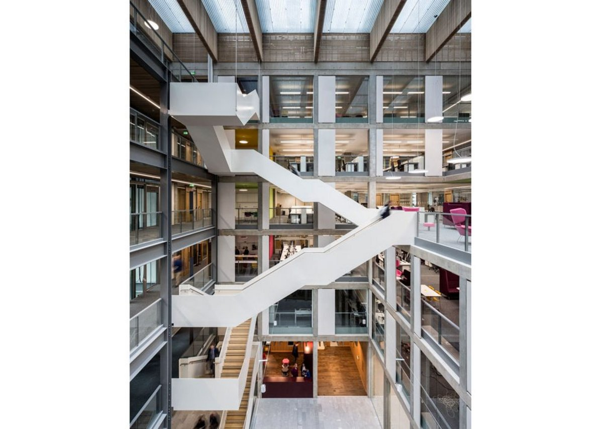 Atrium of Bayes Centre (2019) for academics and students working in the fields of Data Technology, Design Informatics, Maths and Robotics with industrial collaborators at the University of Edinburgh. The second phase was informed by a full post occupancy study.