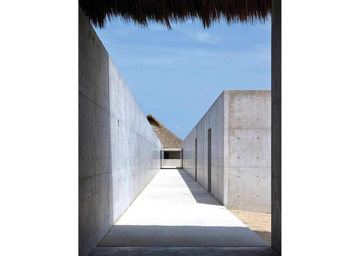 View towards the 'Large Villa'. The 300m long wall separates public from private areas. The concrete box on the right accommodates office and gallery space.