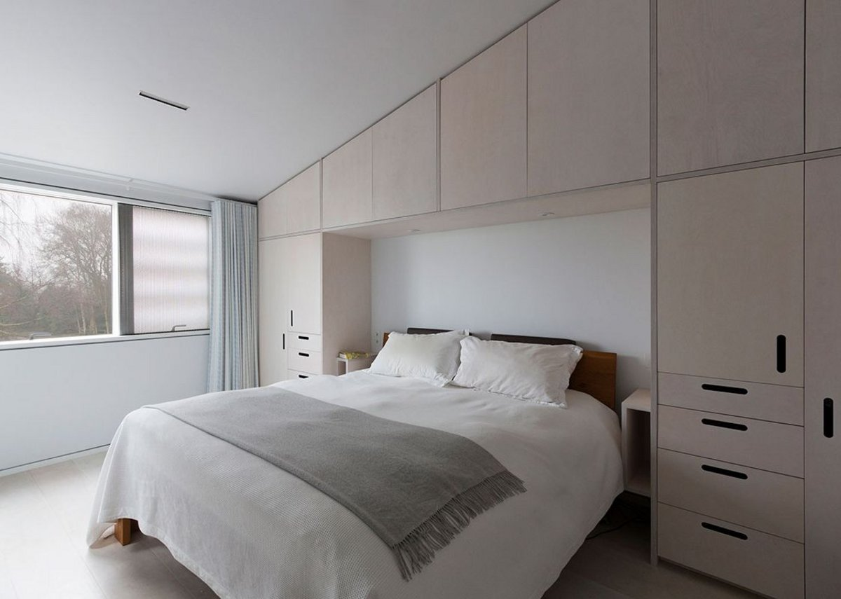 The smaller, intimate space of a bedroom with Velfac window.