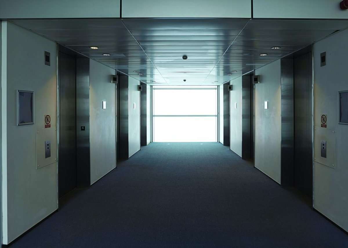 The original lift lobbies were low and dark – perhaps victims of value-engineering.