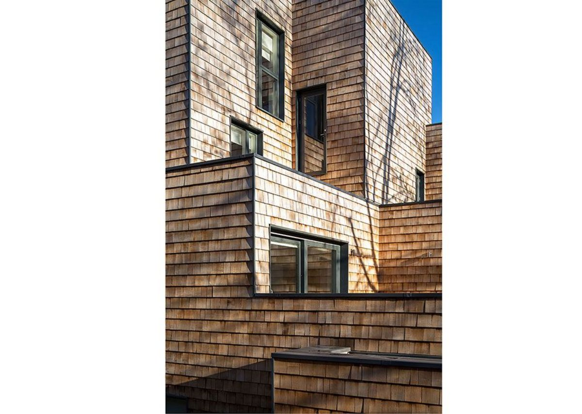 Cedar shingles cover facing elevations…