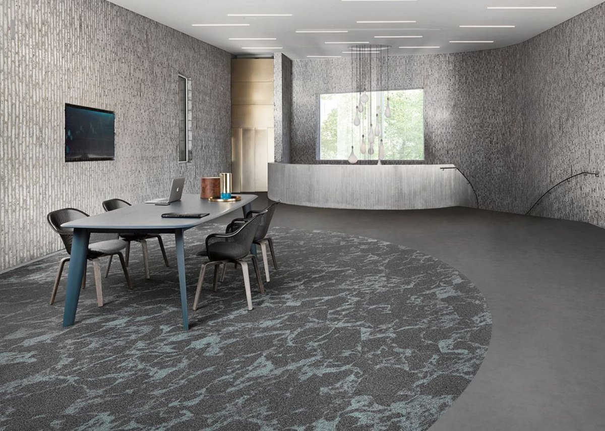Desso Resonance carpet tiles are designed to combine seamlessly with Tarkett's iD Square luxury vinyl tile range.