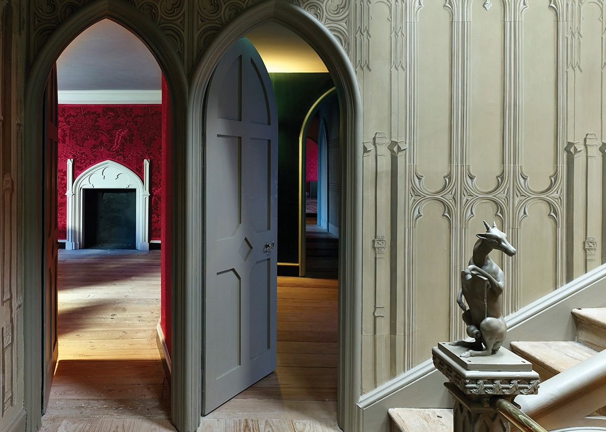 View into the Red Bedchamber with its handmade wallpaper.