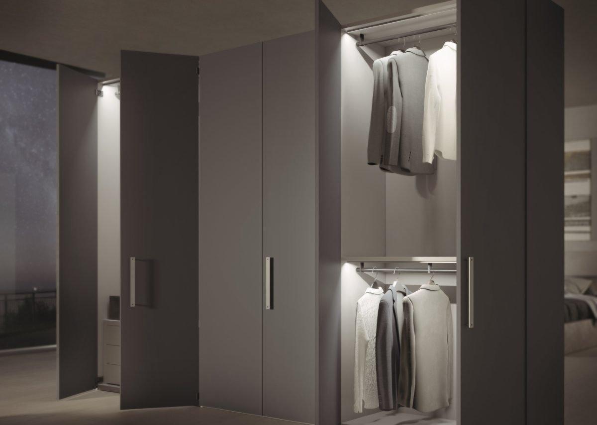Fitted bedroom storage with Häfele Loox LED hanging rail strip lights.