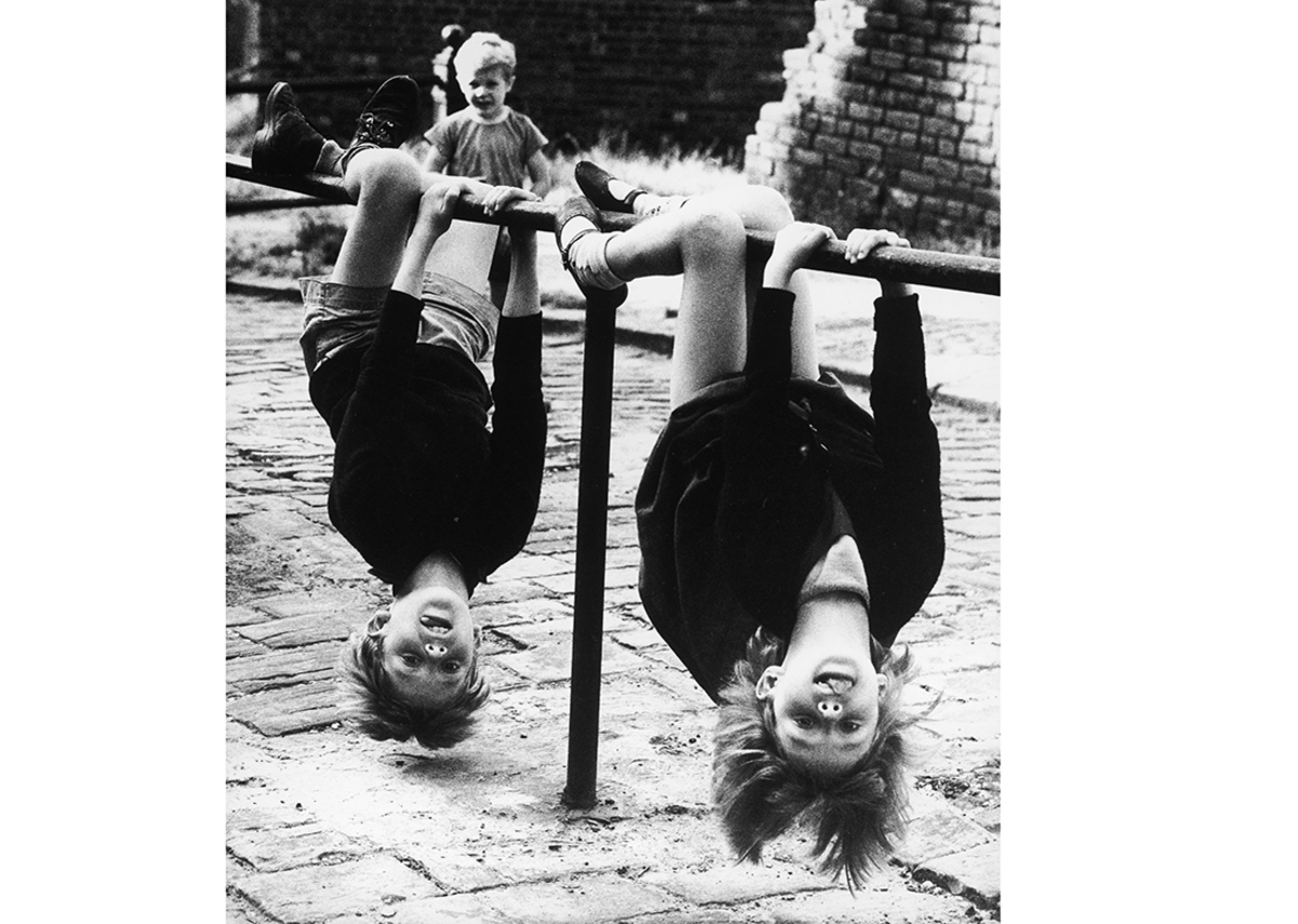 Girls upside down by Shirley Baker.