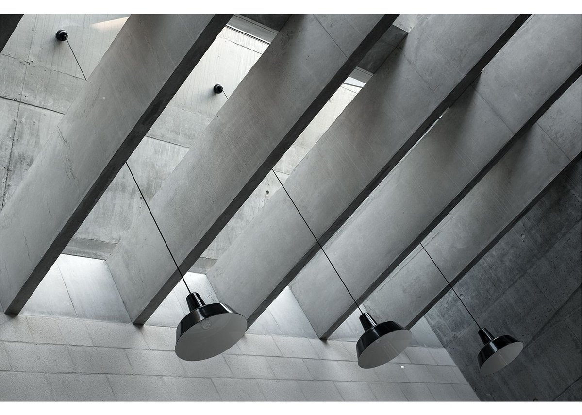Concrete fin beams below the north facing rooflights of the studio space don't only look impressive, they act as baffles to deal with potential solar gain from east or west.