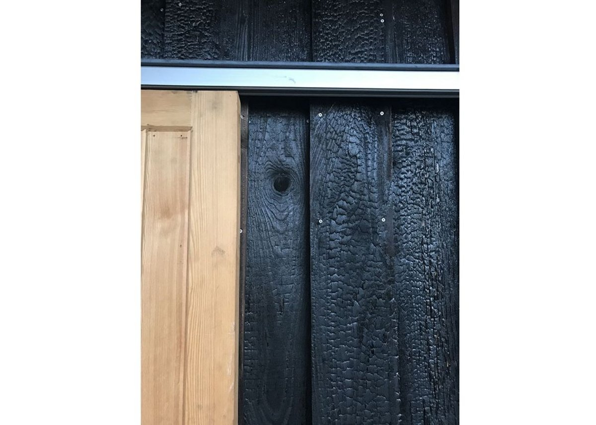 Charred timber on the exterior of the extension.