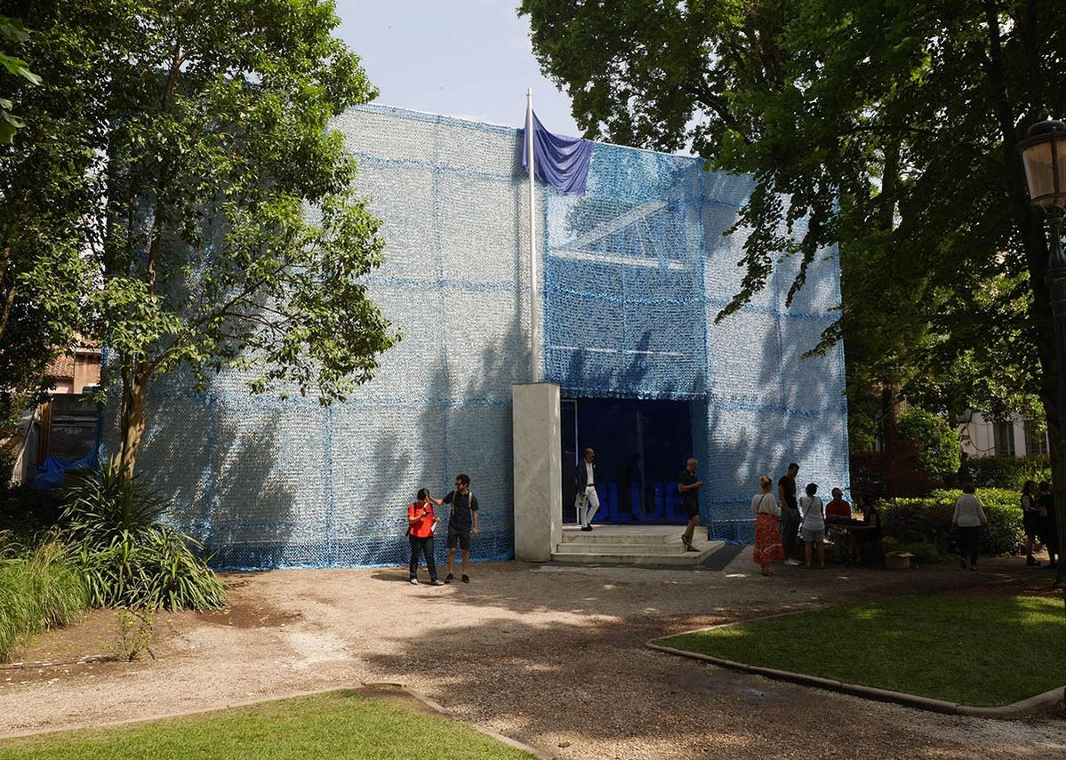 The Dutch turn their pavilion into Blue, a UN peacekeeping outpost.