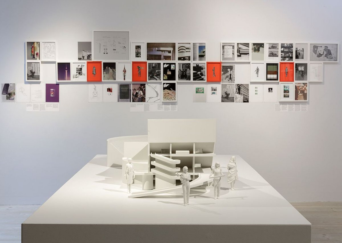 Ala Younis, Plan for Feminist Greater Baghdad exhibition installation view, 2018. In the foreground is a model of Le Corbusier's gymnasium in Baghdad accompanied by figures of women from the Plan (fem.) for Greater Baghdad exhibition narrative.